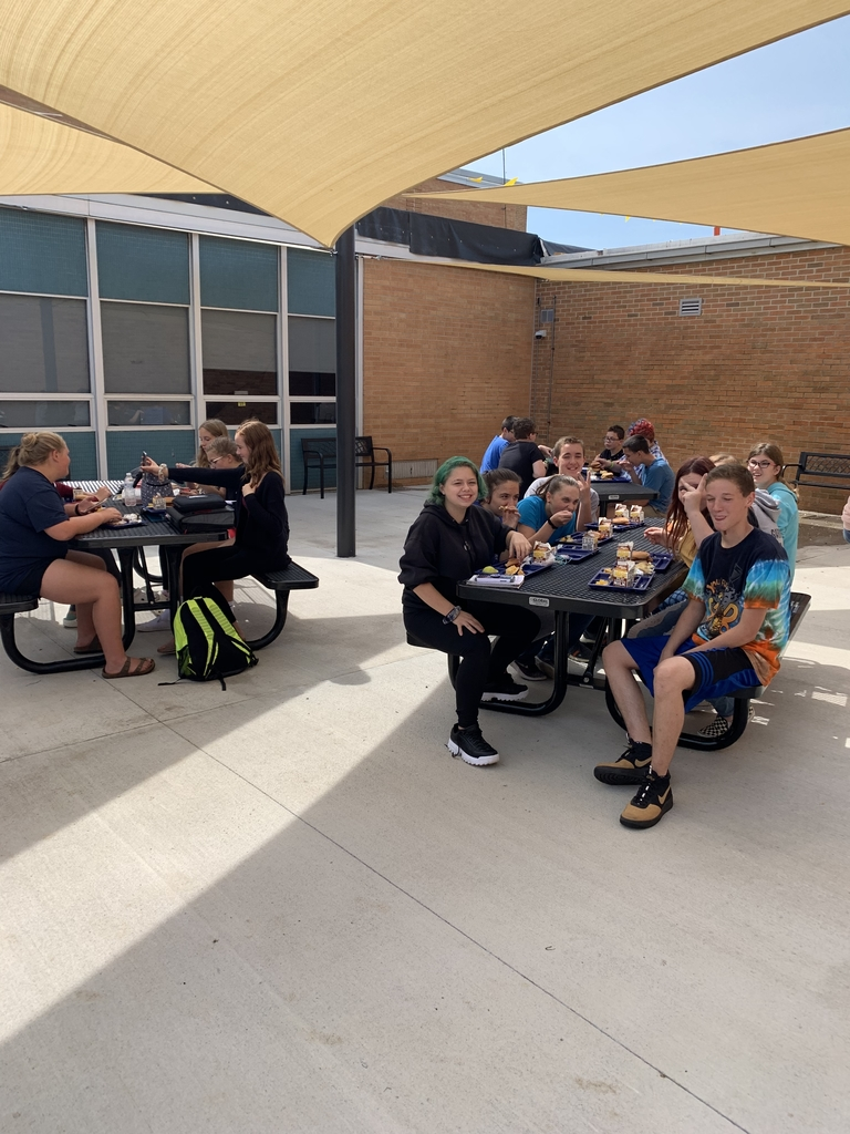 Middle school students enjoying lunch in the new courtyard!